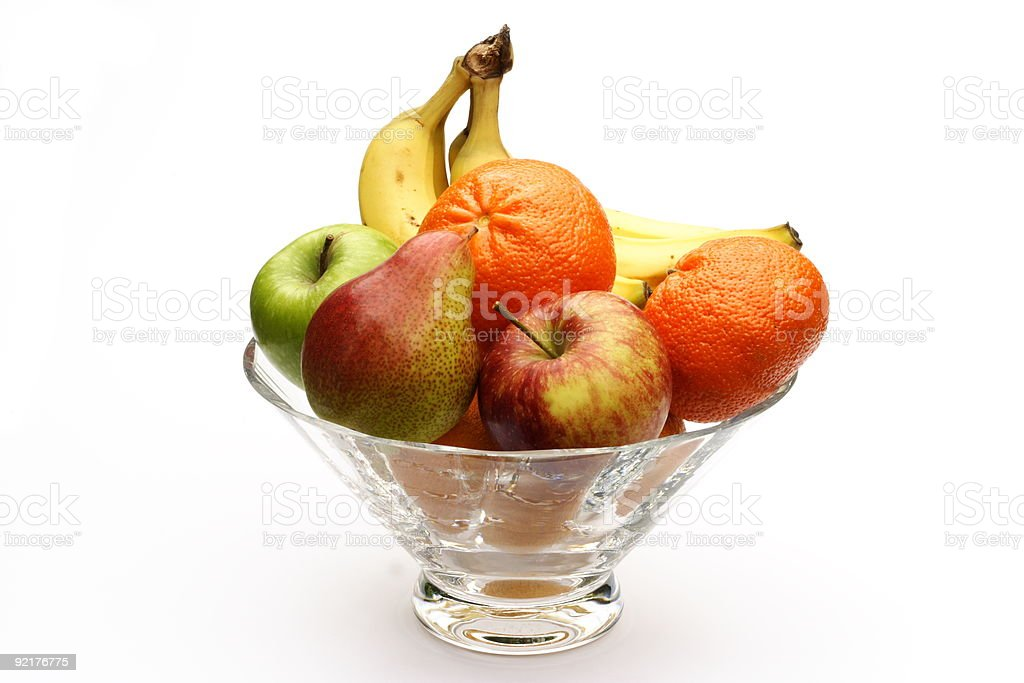Fruits in glass bowl in white background stock photo
