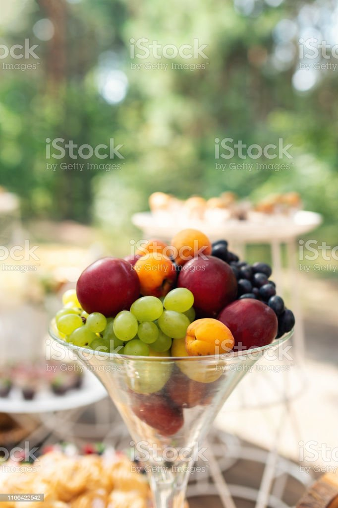 Fruits in glass. Wedding decor. Summer wedding in the wood. grapes,...