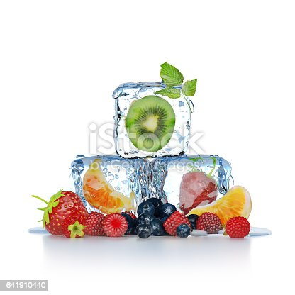 Fresh fruits inside ice cubes and near them, isolated on white background
