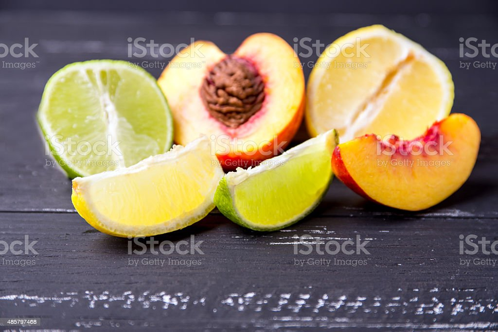 Fruits on a dark wooden background. stock photo