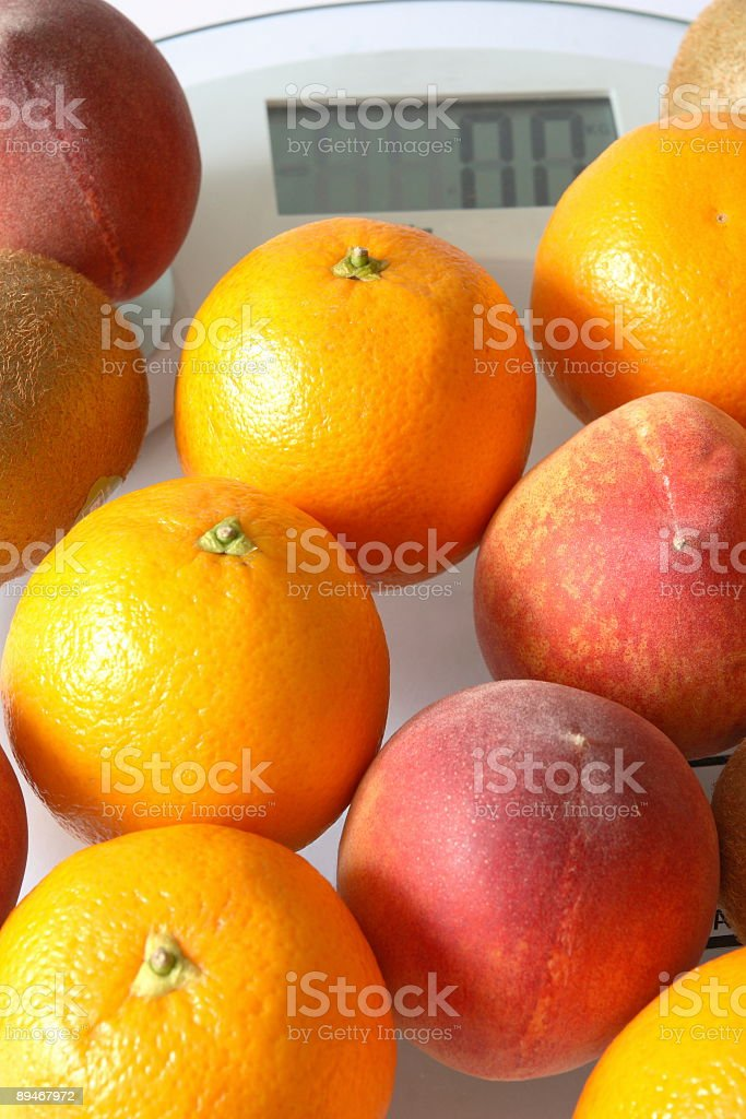 Fruits on Scale royalty-free stock photo