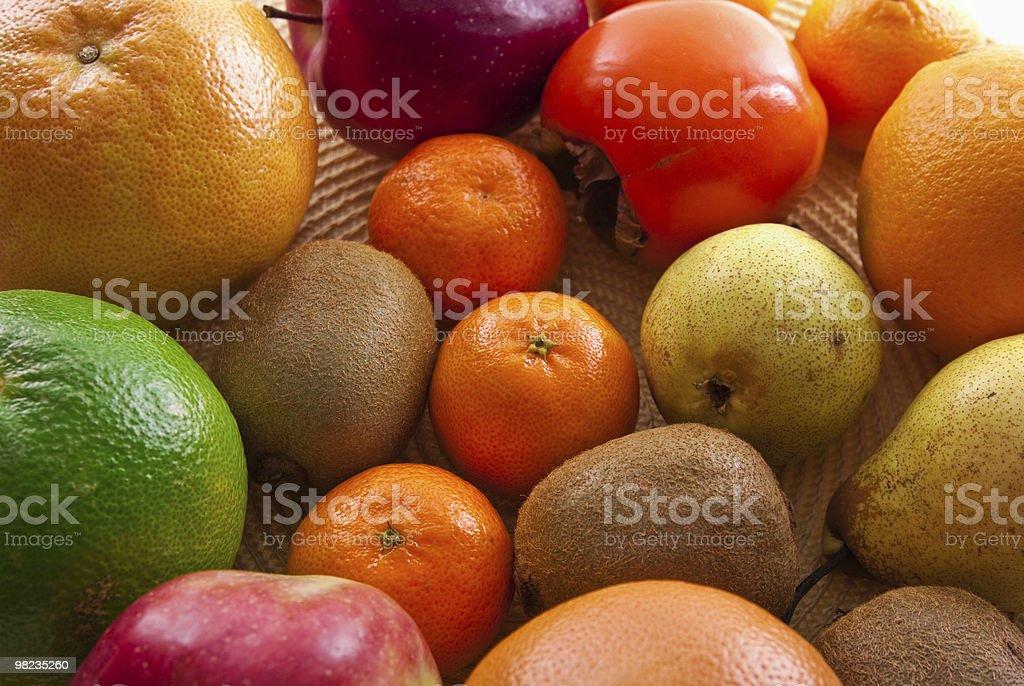 Frutta arancia mela e pera pompelmo kiwi kaki foto stock royalty-free