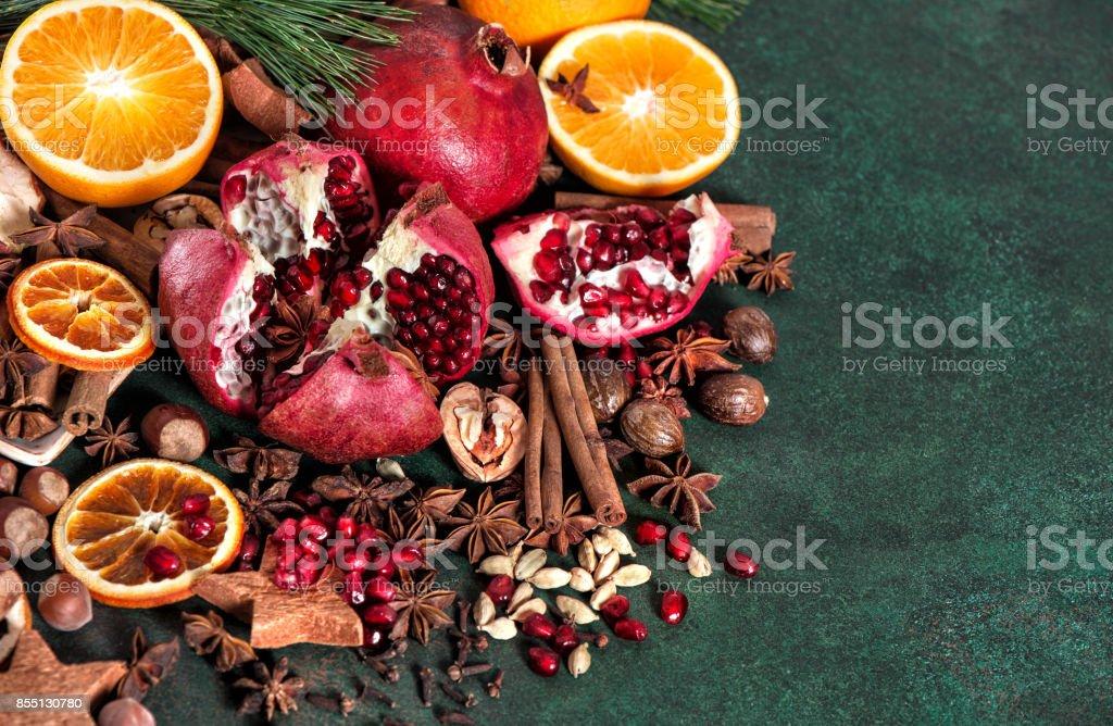 Fruits pomegranate orange spices ingredients mulled wine stock photo