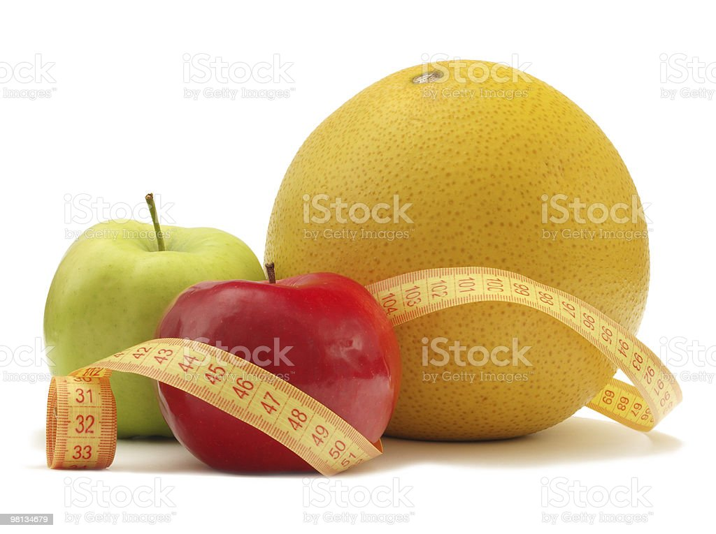 Fruits with measuring instrument on a white background royalty-free stock photo