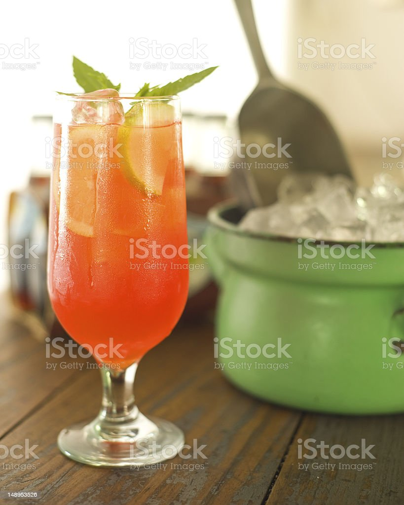 Fruity beverage with mint garnish stock photo