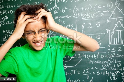 istock Frustated Confused Indian Teenager Student with Mathematics Problems 157585167