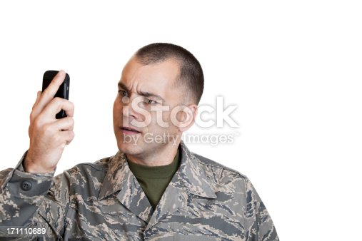 Airman on the phone with a frustrated look on his face.