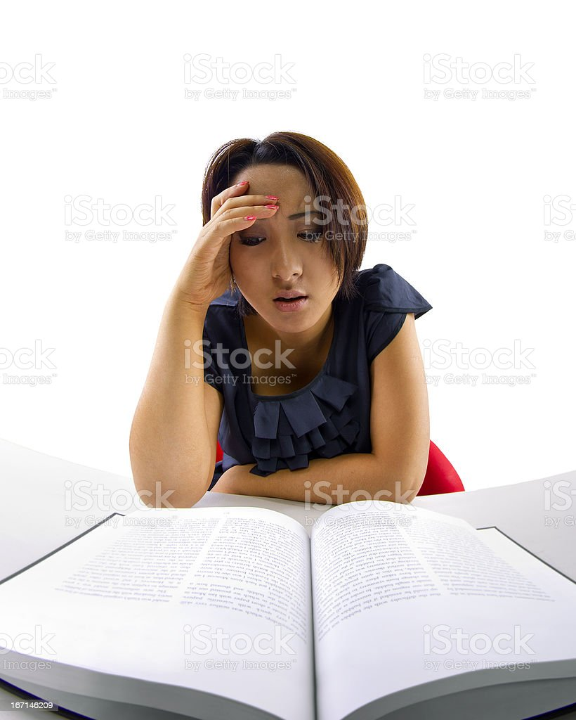 Frustrated Asian Female Student Studying a Book royalty-free stock photo
