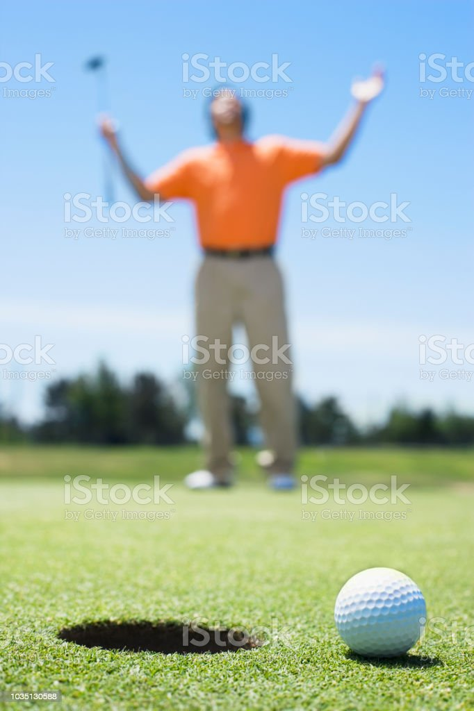 Frustrated Asian man on golf course stock photo