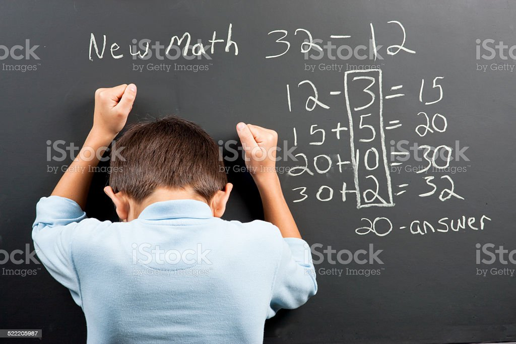 Frustrated at the new math. stock photo