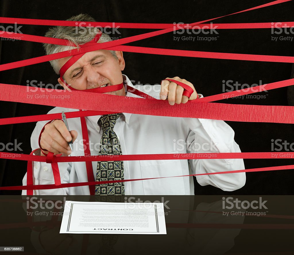 Frustrated business man caught in red tape stopping progress – Foto