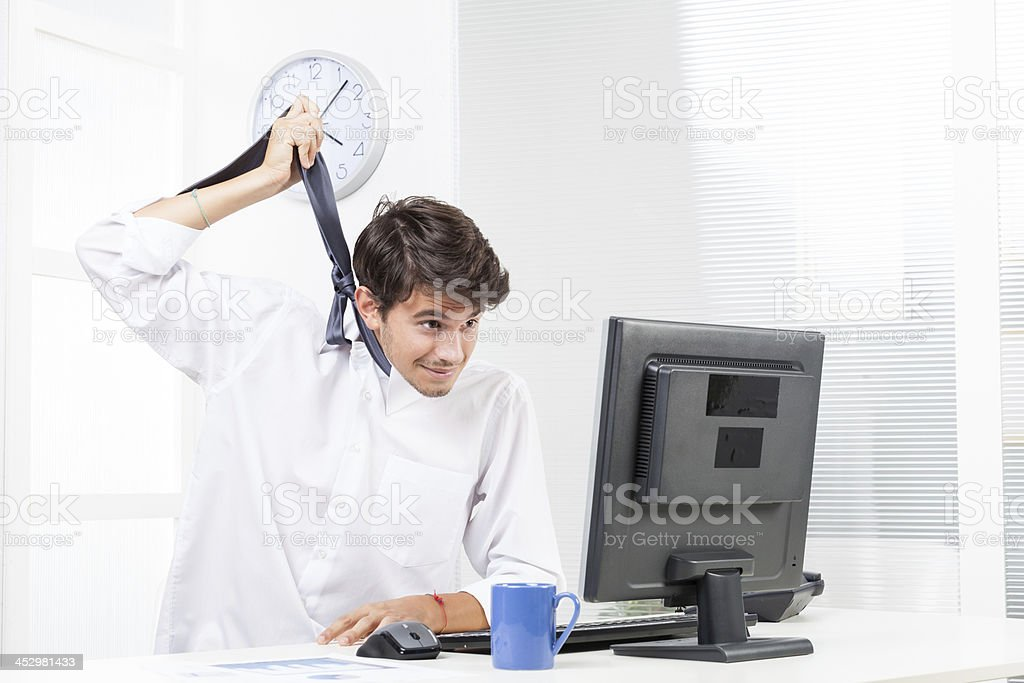 Frustrated business man tries to hang himself stock photo