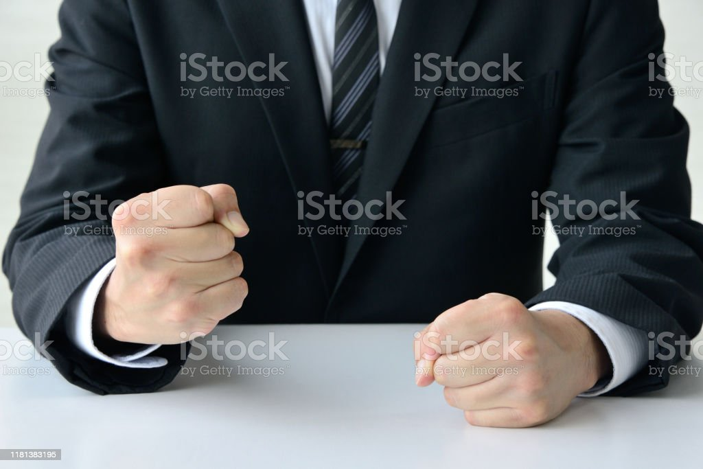 Frustrated business man with solid fist Frustrated business man with solid fist Adult Stock Photo