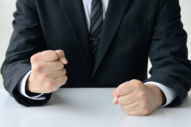 Frustrated business man with solid fist stock photo