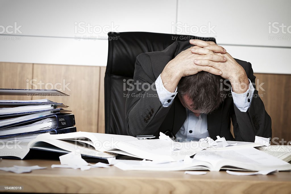 Frustrated business person overloaded with work. stock photo