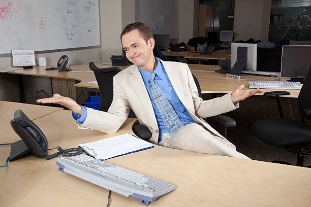 Frustrated businessman at desk stock photo