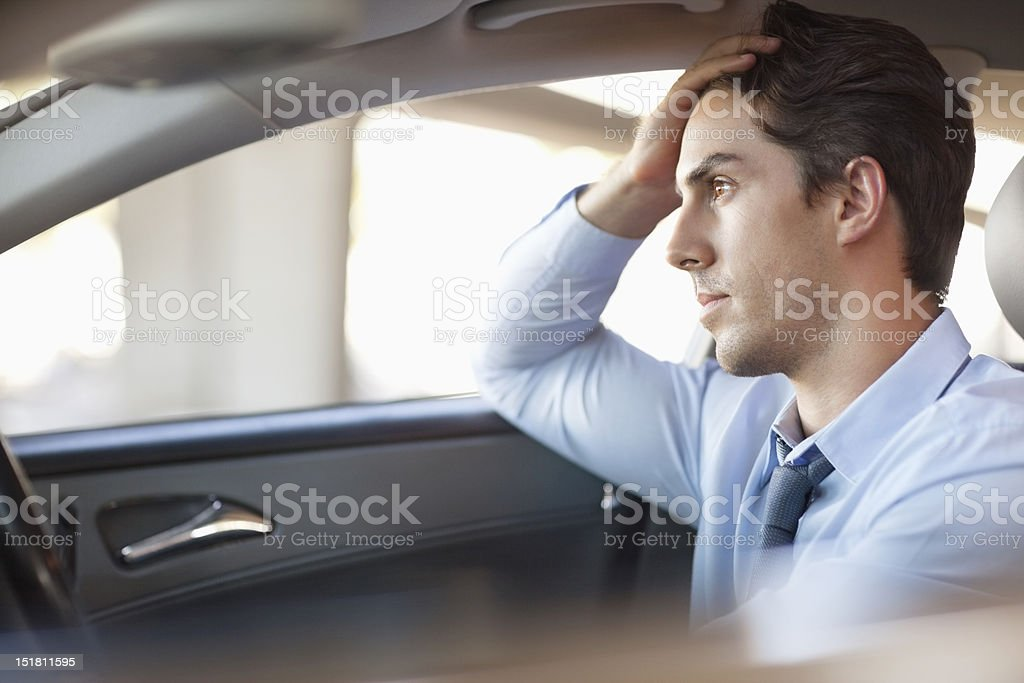 Frustrated businessman driving car stock photo
