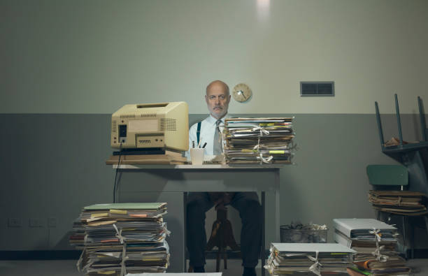 Frustrated businessman overloaded with paperwork stock photo