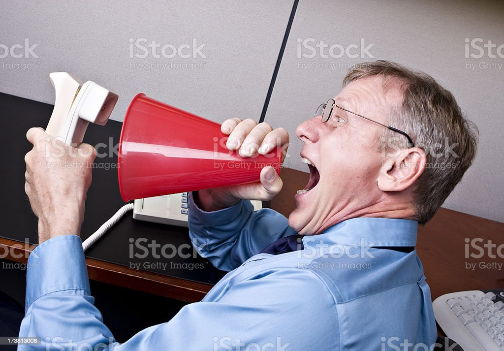 Frustrated Businessman with Megaphone stock photo