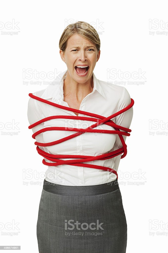 Frustrated Businesswoman Tied In Rope stock photo