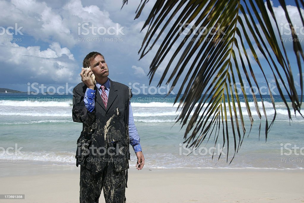Frustrated Castaway Businessman Stands on Hold the Phone stock photo