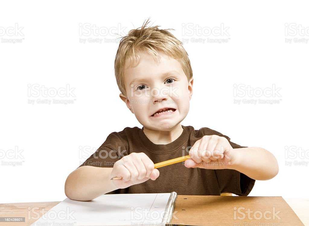Frustrated Child Boy Student Attempts to Break a Pencil royalty-free stock photo