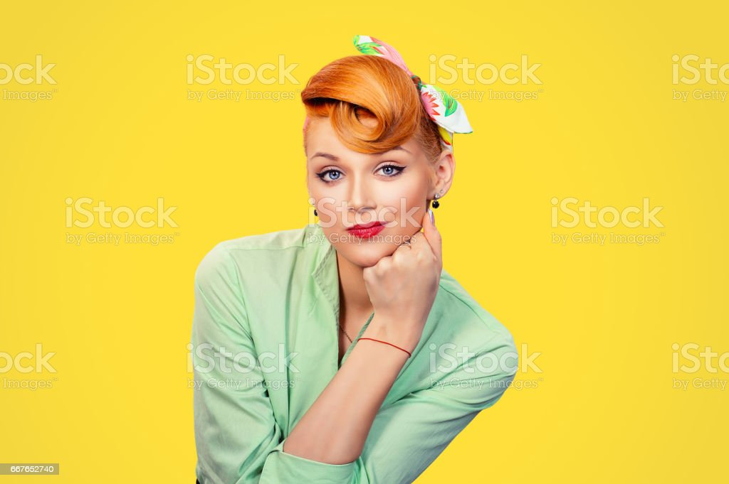 Frustrated Closeup portrait headshot skeptical young lady woman girl looking suspicious disgust on face mixed with disapproval isolated yellow background.Negative human emotion face expression feeling stock photo