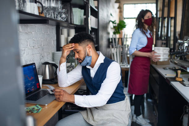 Frustrated coffee shop manager in cafe, small business, coronavirus and new normal concept. stock photo