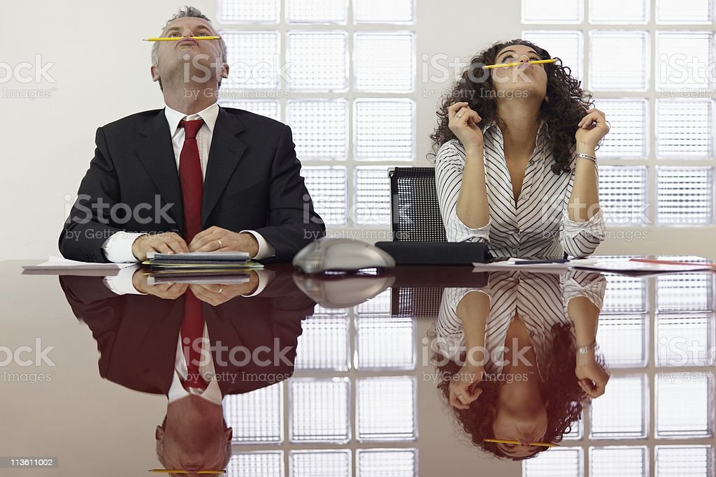 Frustrated colleagues playing at conference call stock photo