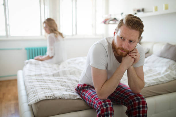 Frustrated couple arguing and having marriage problems Frustrated couple arguing and having marriage problems background of the sad couple fighting bed stock pictures, royalty-free photos & images