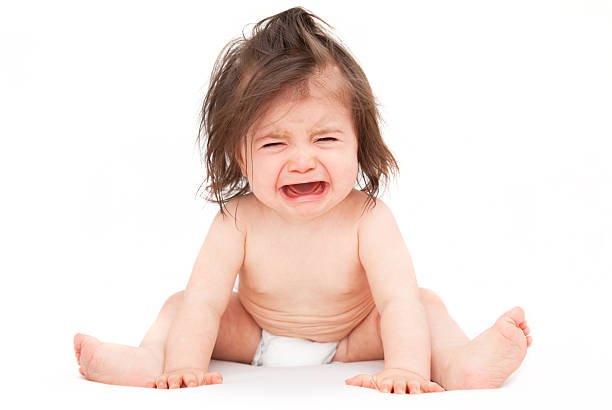 frustrated crying baby stock photo