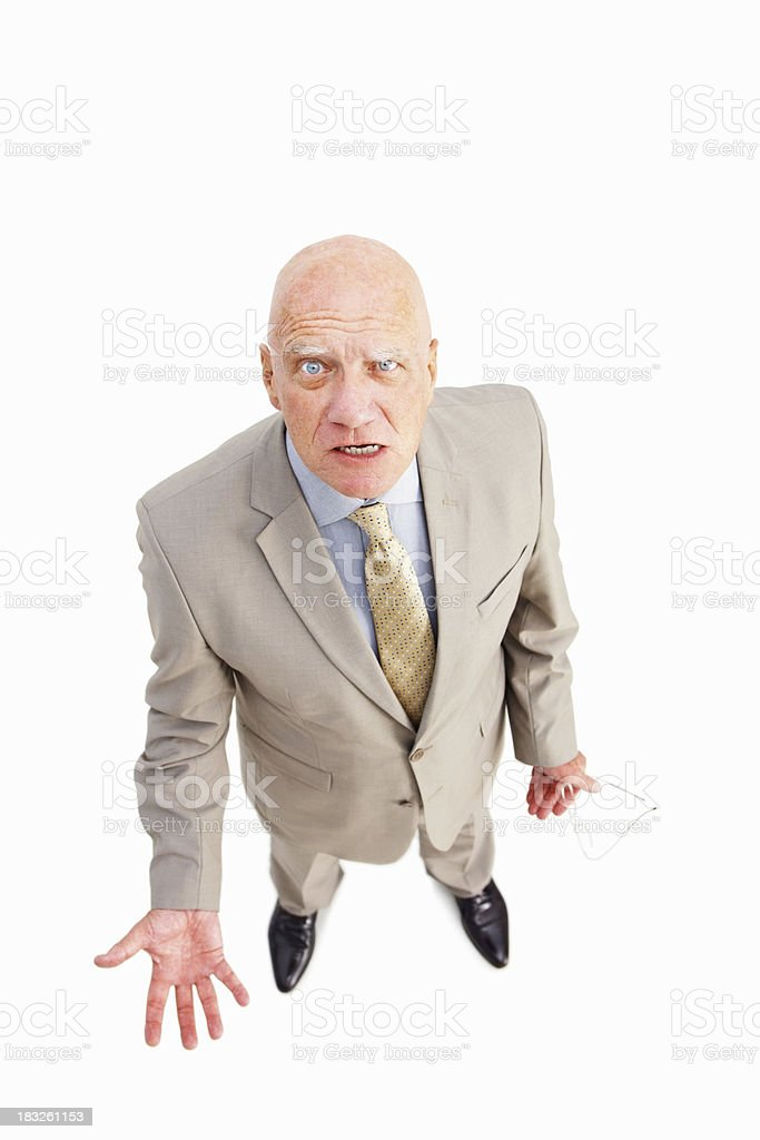 Frustrated elderly businessman standing against white background royalty-free stock photo