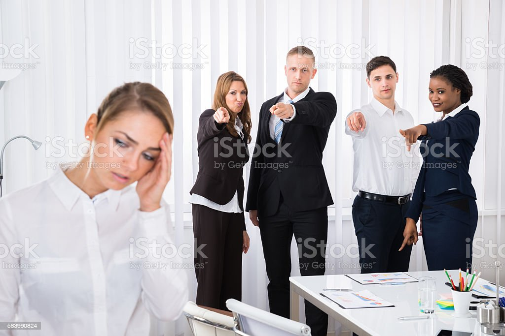 Frustrated Female Colleague In Office stock photo