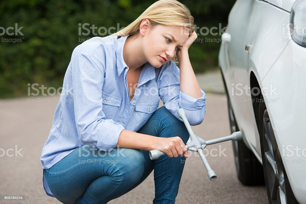Female Mechanic With Tire Iron Stock Of Beauty Anyporn 1