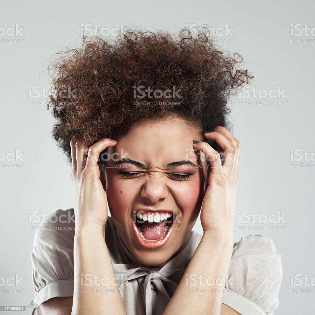 Frustrated girl Portrait of teenaged afro girl screaming with eyes closed . Studio shot, grey background. 18-19 Years Stock Photo