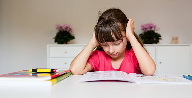 Frustrated girl with homework stock photo