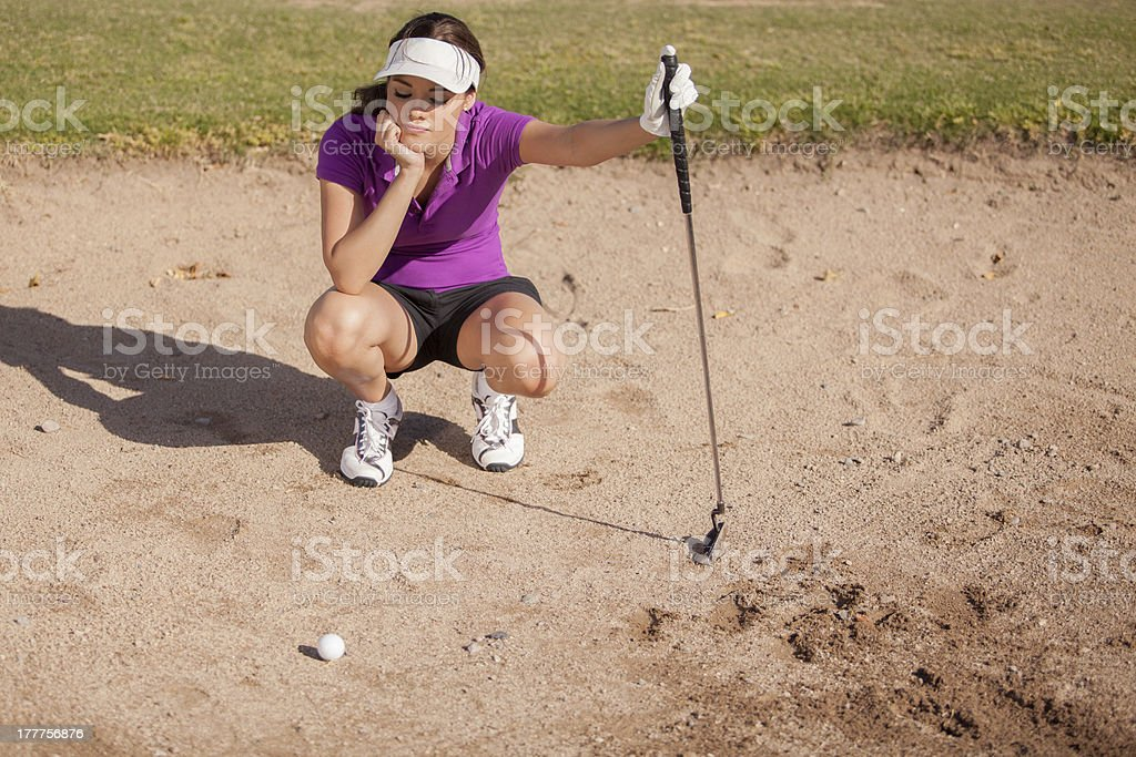 Frustrated golfer in a sand trap stock photo