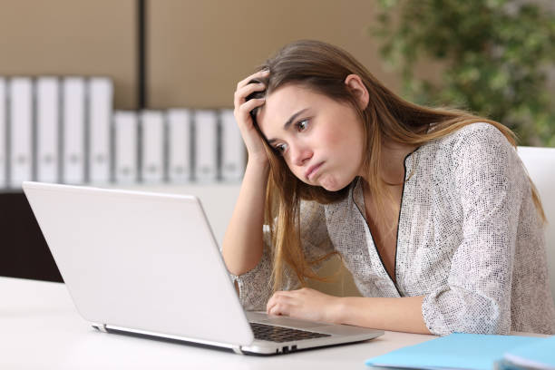 frustrated intern working on line at office - unemployment stock pictures, royalty-free photos & images