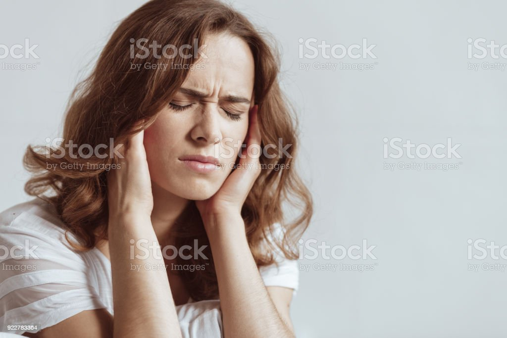 Frustrated lady feeling severe headache royalty-free stock photo