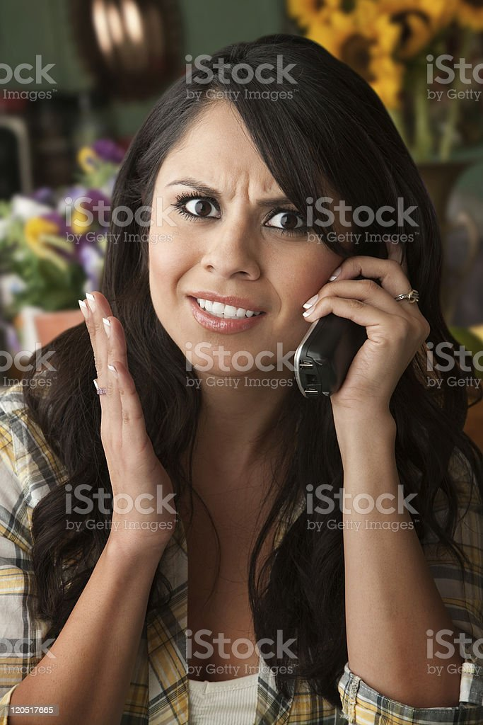 Frustrated Latina Woman on Phone royalty-free stock photo