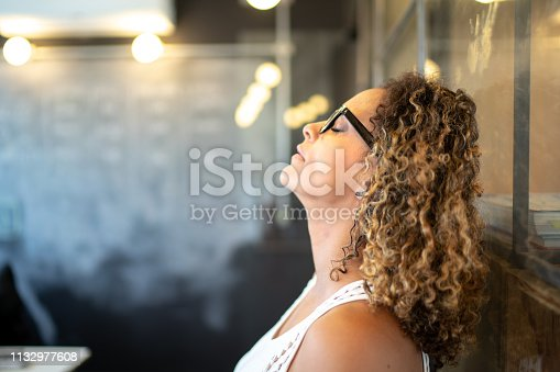 istock Frustrated latinx woman feeling loser standing at the office 1132977608