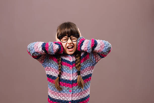 frustrated little nerdy girl - covering ears stock photos and pictures