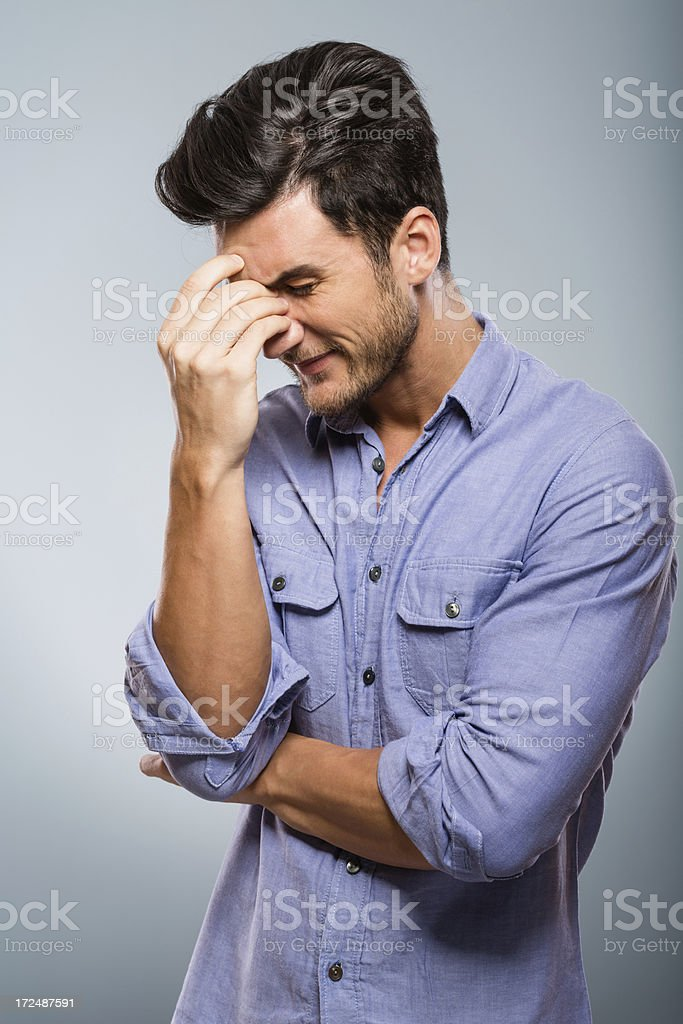 Frustrated man facing problems stock photo