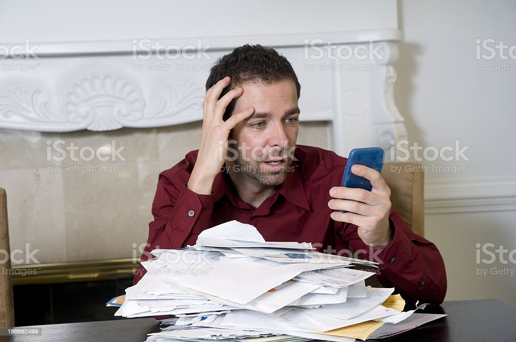Frustrated man in debt. royalty-free stock photo