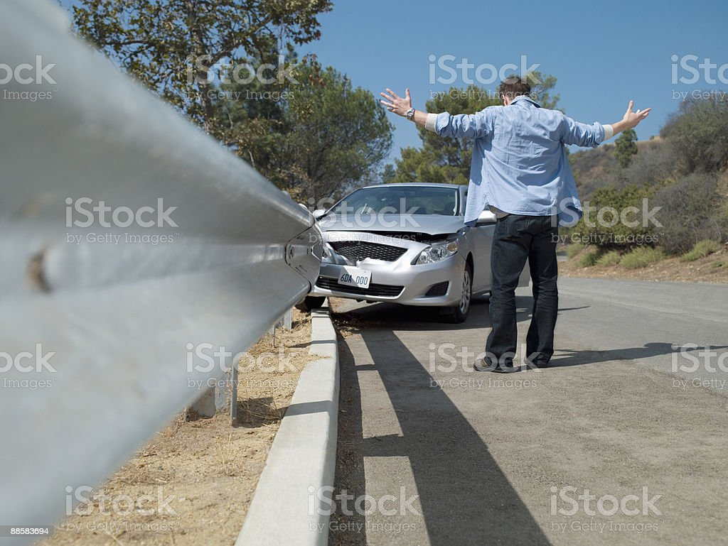 Frustrated man looking at crashed car 免版稅 stock photo