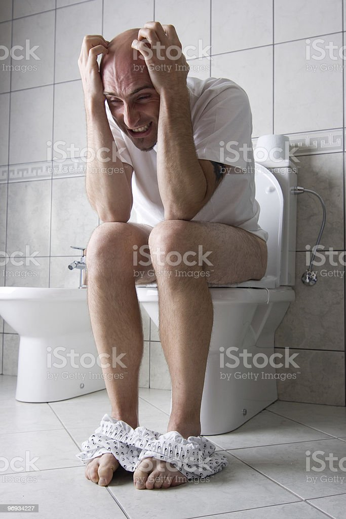 Frustrated man on toilet seat royalty-free stock photo