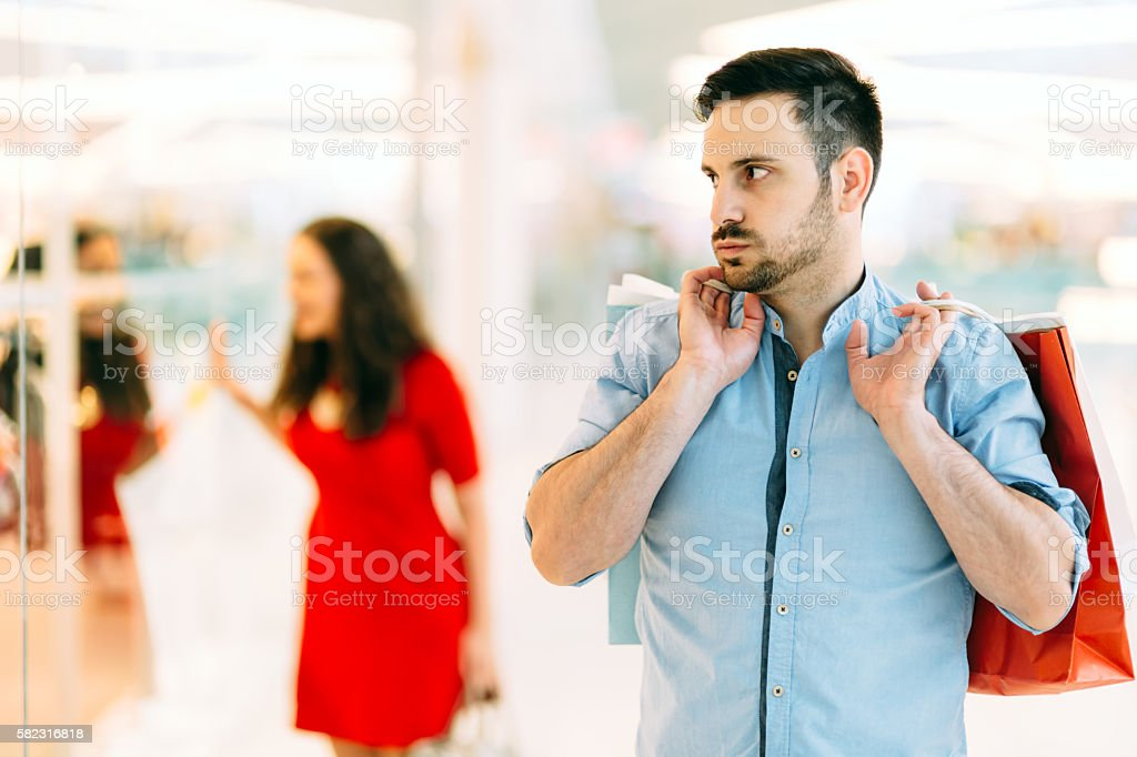 Frustrated man waiting for spouse stock photo