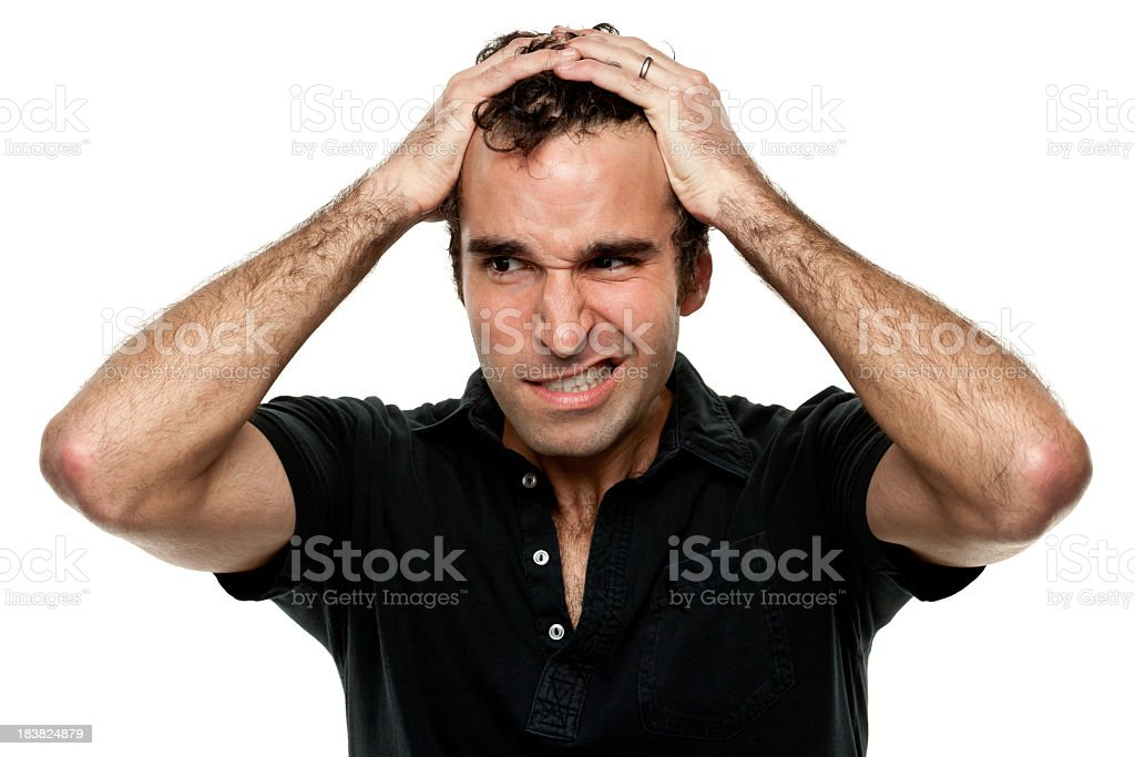 Frustrated Man With Hands In Hair royalty-free stock photo