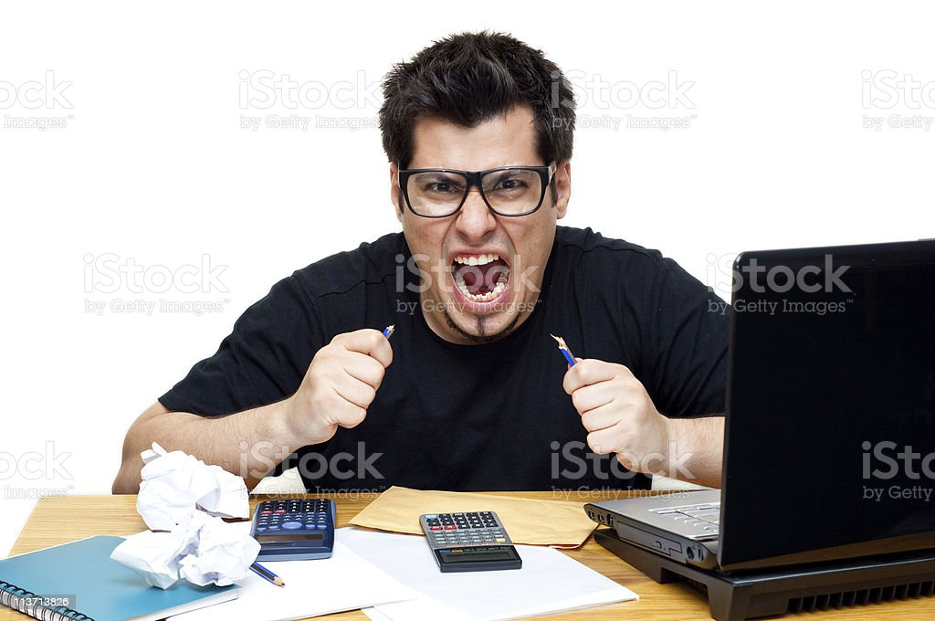frustrated nerdy accountant at his desk royalty-free stock photo