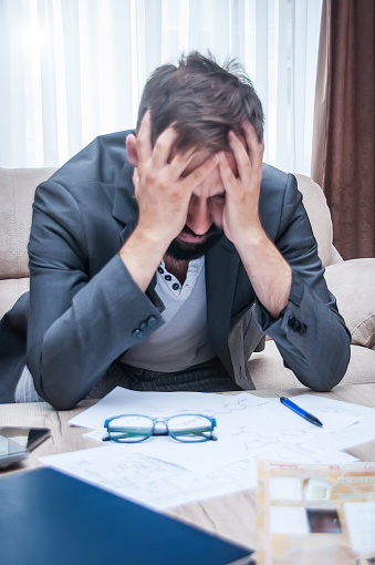 690496350 istock photo Frustrated office manager overloaded with work. 982935390